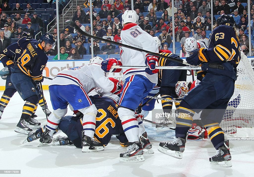 <a gi-track='captionPersonalityLinkClicked' href=/galleries/search?phrase=Thomas+Vanek&family=editorial&specificpeople=570606 ng-click='$event.stopPropagation()'>Thomas Vanek</a> #26 of the Buffalo Sabres scores a goal with 1.9 seconds remaining in the third period to tie the game against the Montreal Canadiens on February 7, 2013 at the First Niagara Center in Buffalo, New York. Buffalo defeated Montreal, 4-3, in an overtime shootout.