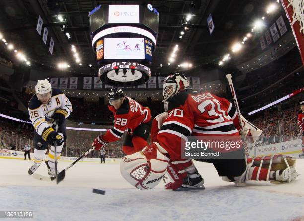 Thomas Vanek of the Buffalo Sabres scores a second period goal against Martin Brodeur of the New Jersey Devils at the Prudential Center on December...