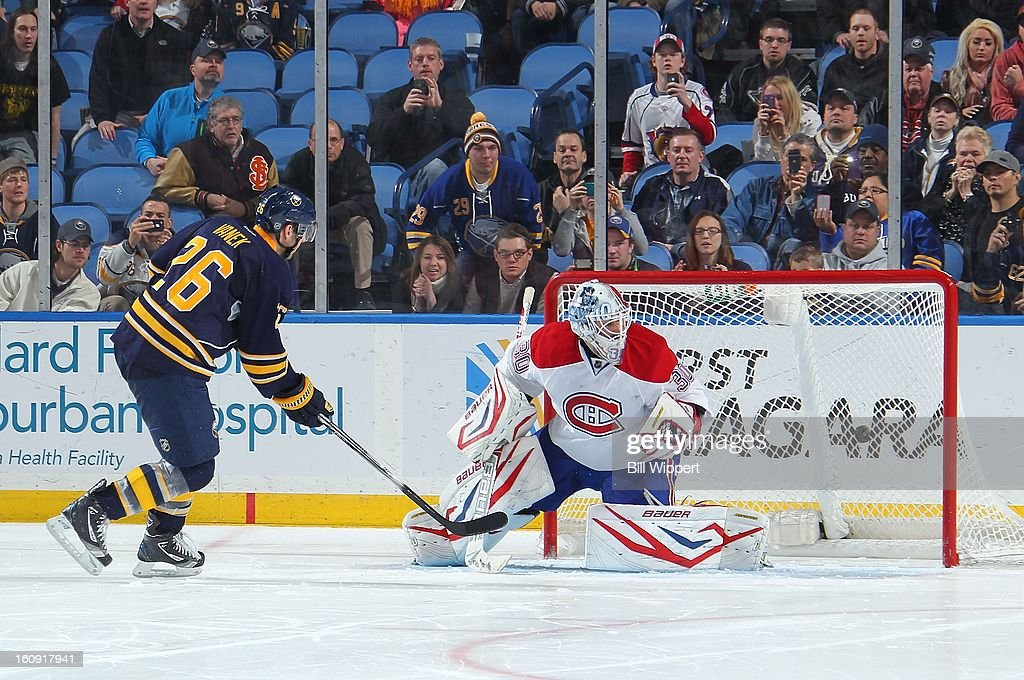 <a gi-track='captionPersonalityLinkClicked' href=/galleries/search?phrase=Thomas+Vanek&family=editorial&specificpeople=570606 ng-click='$event.stopPropagation()'>Thomas Vanek</a> #26 of the Buffalo Sabres scores a shootout goal against <a gi-track='captionPersonalityLinkClicked' href=/galleries/search?phrase=Peter+Budaj&family=editorial&specificpeople=228123 ng-click='$event.stopPropagation()'>Peter Budaj</a> #30 of the Montreal Canadiens on February 7, 2013 at the First Niagara Center in Buffalo, New York. Buffalo defeated Montreal, 4-3, in an overtime shootout.