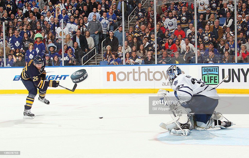 <a gi-track='captionPersonalityLinkClicked' href=/galleries/search?phrase=Thomas+Vanek&family=editorial&specificpeople=570606 ng-click='$event.stopPropagation()'>Thomas Vanek</a> #26 of the Buffalo Sabres scores a third period goal against James Reimer #34 of the Toronto Maple Leafs at First Niagara Center on December 16, 2011 in Buffalo, New York.