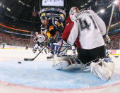 Thomas Vanek of the Buffalo Sabres scores a third period goal against Craig Anderson of the Colorado Avalanche on January 9 2010 at HSBC Arena in...
