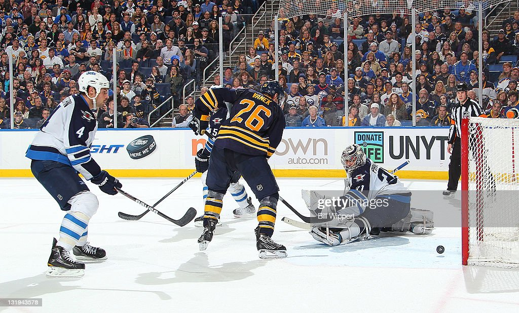 <a gi-track='captionPersonalityLinkClicked' href=/galleries/search?phrase=Thomas+Vanek&family=editorial&specificpeople=570606 ng-click='$event.stopPropagation()'>Thomas Vanek</a> #26 of the Buffalo Sabres scores the game winning overtime goal against Ondrej Pavelec #31 of the Winnipeg Jets at First Niagara Center on November 8, 2011 in Buffalo, New York.