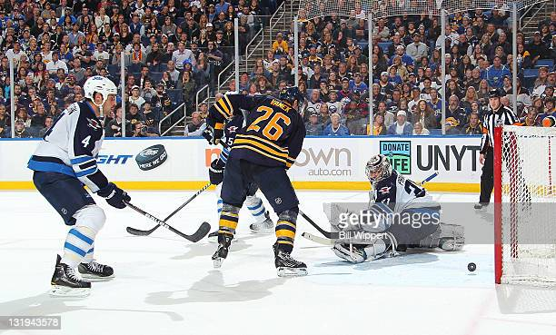 Thomas Vanek of the Buffalo Sabres scores the game winning overtime goal against Ondrej Pavelec of the Winnipeg Jets at First Niagara Center on...