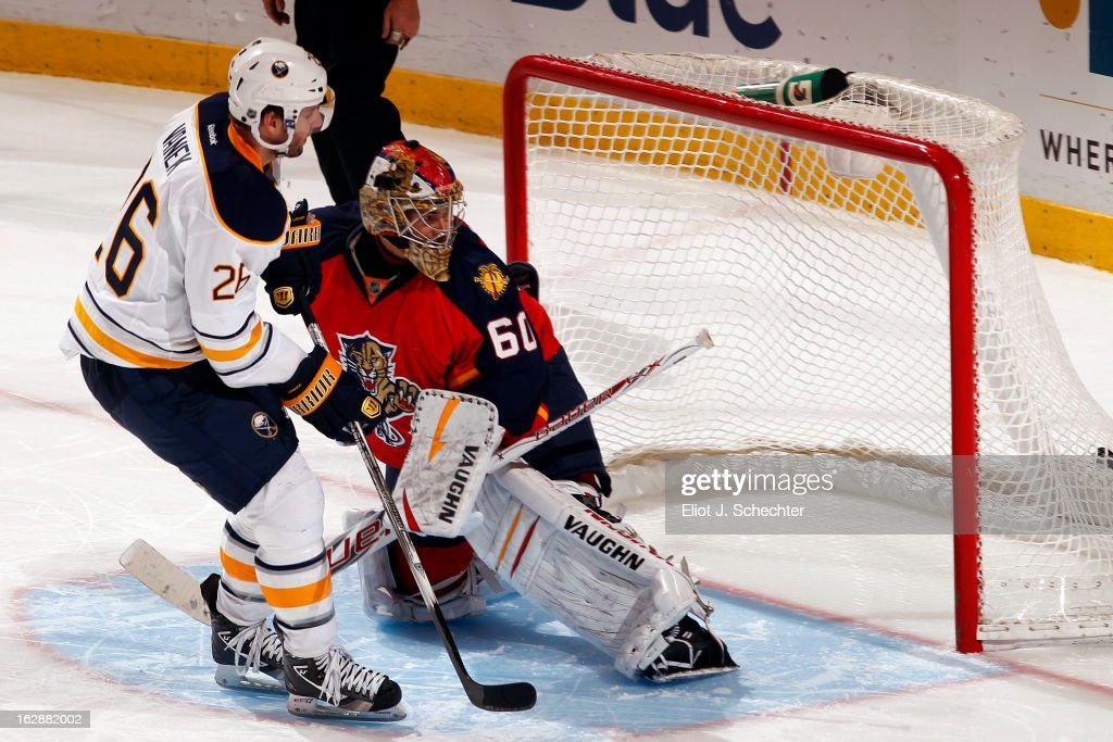 <a gi-track='captionPersonalityLinkClicked' href=/galleries/search?phrase=Thomas+Vanek&family=editorial&specificpeople=570606 ng-click='$event.stopPropagation()'>Thomas Vanek</a> #26 of the Buffalo Sabres shoots and scores the game winning goal in a shootout against Goaltender <a gi-track='captionPersonalityLinkClicked' href=/galleries/search?phrase=Jose+Theodore&family=editorial&specificpeople=202011 ng-click='$event.stopPropagation()'>Jose Theodore</a> #60 of the Florida Panthers at the BB&T Center on February 28, 2013 in Sunrise, Florida.
