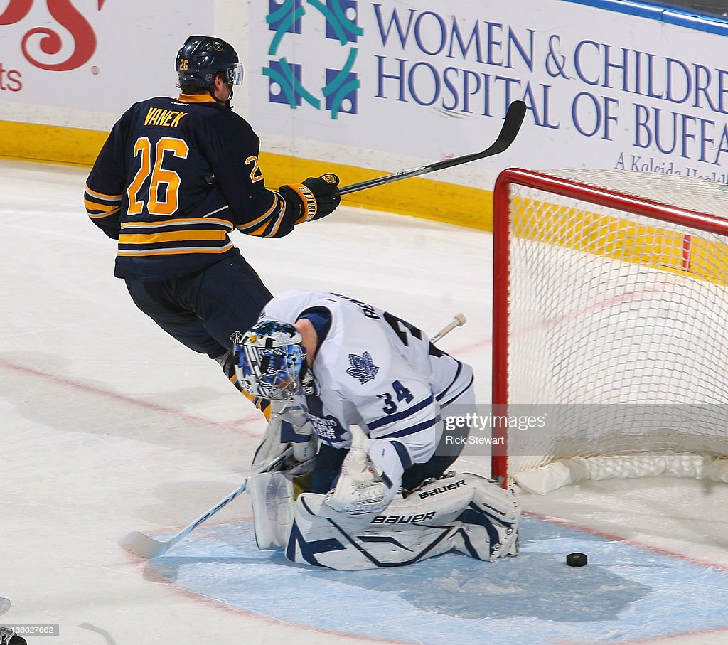 <a gi-track='captionPersonalityLinkClicked' href=/galleries/search?phrase=Thomas+Vanek&family=editorial&specificpeople=570606 ng-click='$event.stopPropagation()'>Thomas Vanek</a> #26 of the Buffalo Sabres skates away from the net after scoring his second goal against James Reimer #34 of the Toronto Maple Leafs at First Niagara Center on December 16, 2011 in Buffalo, New York.