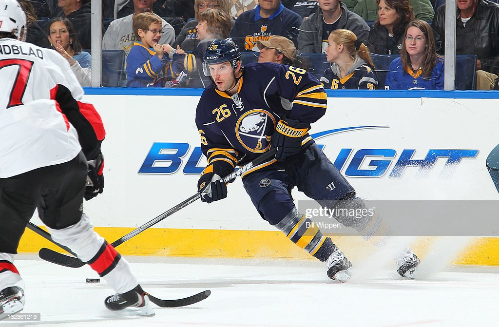 <a gi-track='captionPersonalityLinkClicked' href=/galleries/search?phrase=Thomas+Vanek&family=editorial&specificpeople=570606 ng-click='$event.stopPropagation()'>Thomas Vanek</a> #26 of the Buffalo Sabres stops to make a pass in front of David Rundblad #7 of the Ottawa Senators at First Niagara Center on November 11, 2011 in Buffalo, New York.