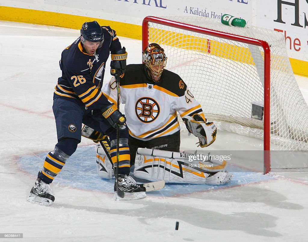 Thomas Vanek #26 of the Buffalo Sabres tries to make a play on the puck in front of Tuuka Rask #40 of the Boston Bruins at HSBC Arena on January 29, 2010 in Buffalo, New York.