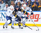 Thomas Vanek of the Buffalo Sabres tries to sneak between Tim Brent and Luke Schenn of the Toronto Maple Leafs at HSBC Arena on February 16 2011 in...