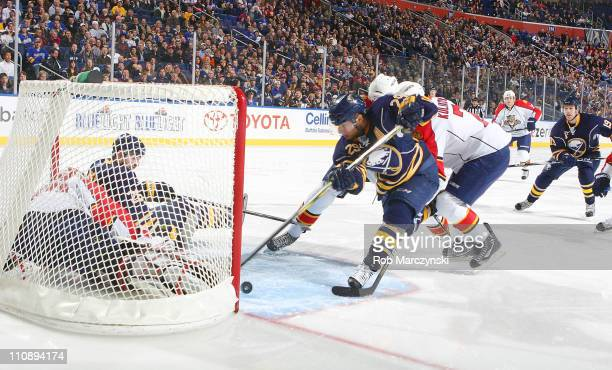 Thomas Vanek of the Buffalo Sabres watches teammate Jason Pominville score a firstperiod goal against Tomas Vokoun of the Florida Panthers as...
