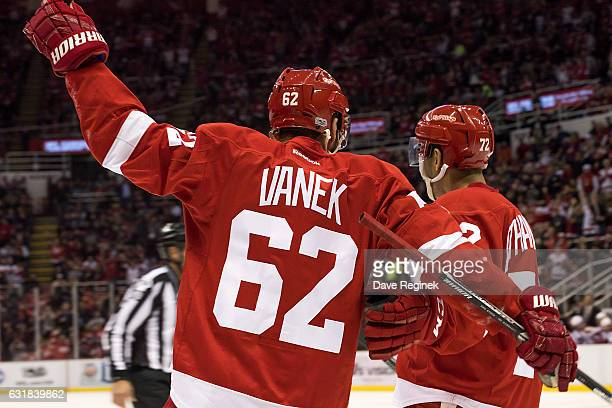 Thomas Vanek of the Detroit Red Wings celebrates a second period goal with teammate Andreas Athanasiou during an NHL game against the Montreal...