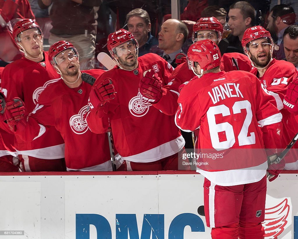 Thomas Vanek #62 of the Detroit Red Wings pounds gloves with teammates on the bench following his second period goal during an NHL game against the Pittsburgh Penguins at Joe Louis Arena on January 14, 2017 in Detroit, Michigan.