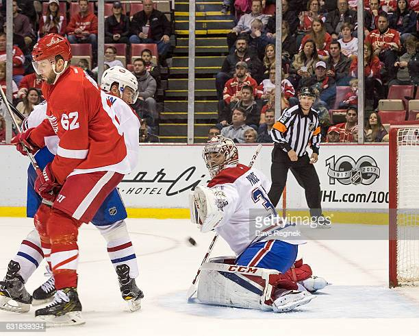 Thomas Vanek of the Detroit Red Wings scores a second period goal on Carey Price of the Montreal Canadiens during an NHL game at Joe Louis Arena on...