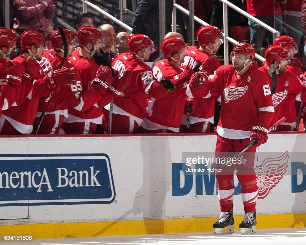 Thomas Vanek of the Detroit Red Wings taps gloves with teammates on the bench after scoring a power play goal during an NHL game against the Columbus...