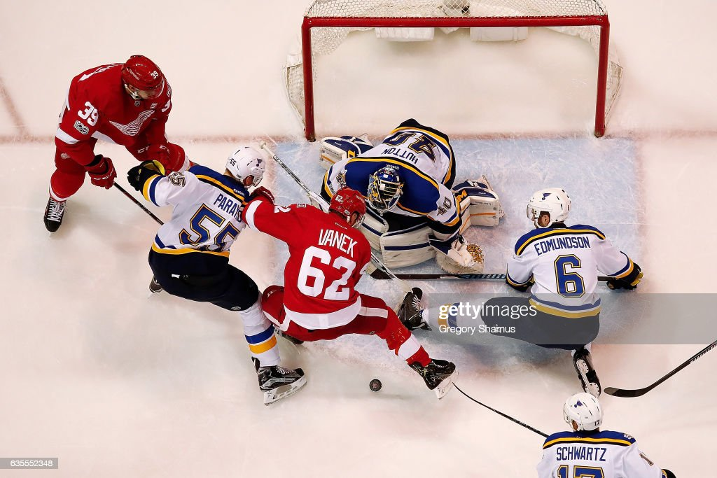 Thomas Vanek #62 of the Detroit Red Wings trie to find the puck next to Carter Hutton #40 of the St. Louis Blues at Joe Louis Arena on February 15, 2017 in Detroit, Michigan. St. Louis won the game 2-0.