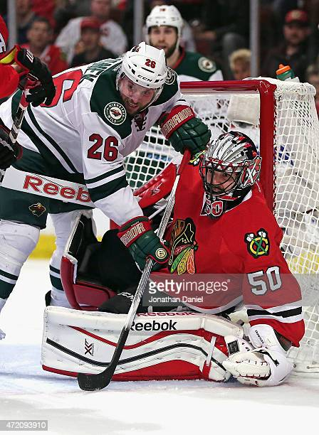 Thomas Vanek of the Minnesota Wild gets called for goal tender interference with this play against Corey Crawford of the Chicago Blackhawks in Game...