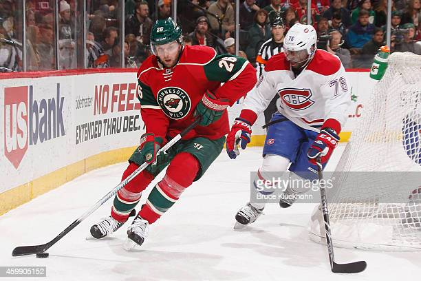 Thomas Vanek of the Minnesota Wild skates with the puck while PK Subban of the Montreal Canadiens defends during the game on December 3 2014 at the...