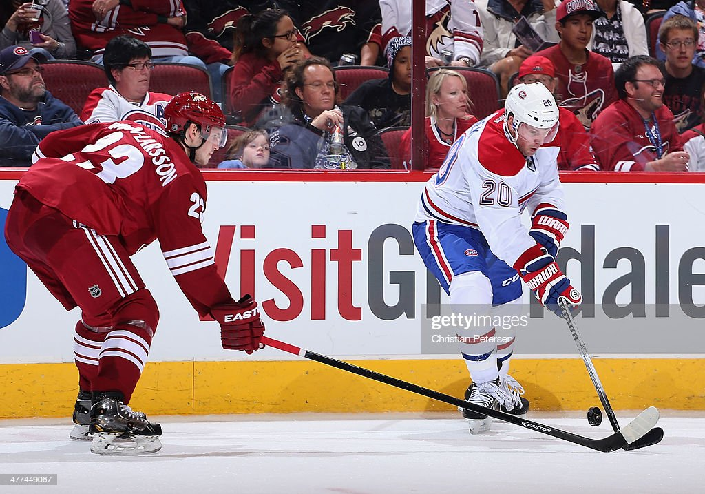 <a gi-track='captionPersonalityLinkClicked' href=/galleries/search?phrase=Thomas+Vanek&family=editorial&specificpeople=570606 ng-click='$event.stopPropagation()'>Thomas Vanek</a> #20 of the Montreal Canadiens handles the puck during the NHL game against the Phoenix Coyotes at Jobing.com Arena on March 6, 2014 in Glendale, Arizona. The Coyotes defeated the Canadiens 5-2.