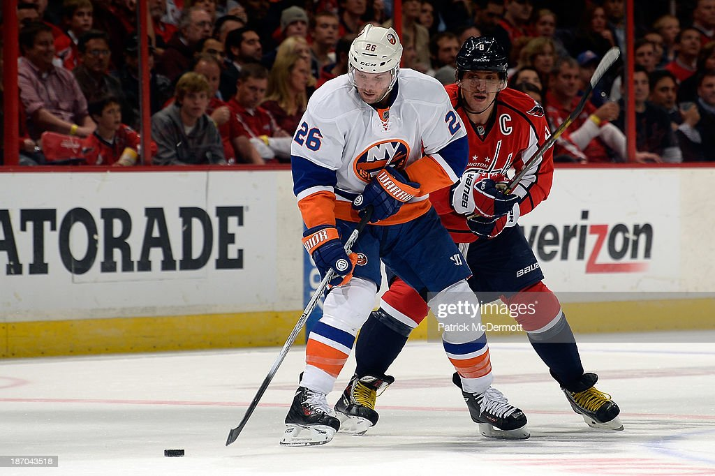 <a gi-track='captionPersonalityLinkClicked' href=/galleries/search?phrase=Thomas+Vanek&family=editorial&specificpeople=570606 ng-click='$event.stopPropagation()'>Thomas Vanek</a> #26 of the New York Islanders battles for the puck against Alex Ovechkin #8 of the Washington Capitals in the second period during an NHL game at Verizon Center on November 5, 2013 in Washington, DC.