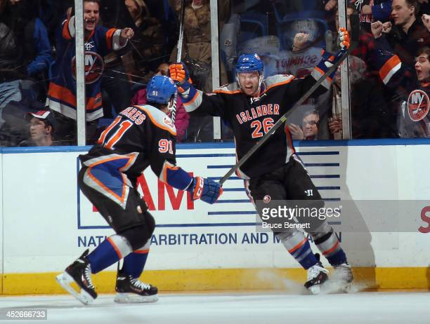 Thomas Vanek of the New York Islanders celebrates his goal at 1809 of the third period against the Washington Capitals along with John Tavares at the...