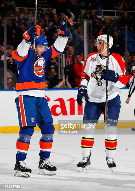 Thomas Vanek of the New York Islanders celebrates his second goal of the first period goal as Tomas Fleischmann of the Florida Panthers looks on at...