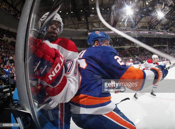Thomas Vanek of the New York Islanders hits PK Subban of the Montreal Canadiens during the second period at the Nassau Veterans Memorial Coliseum on...