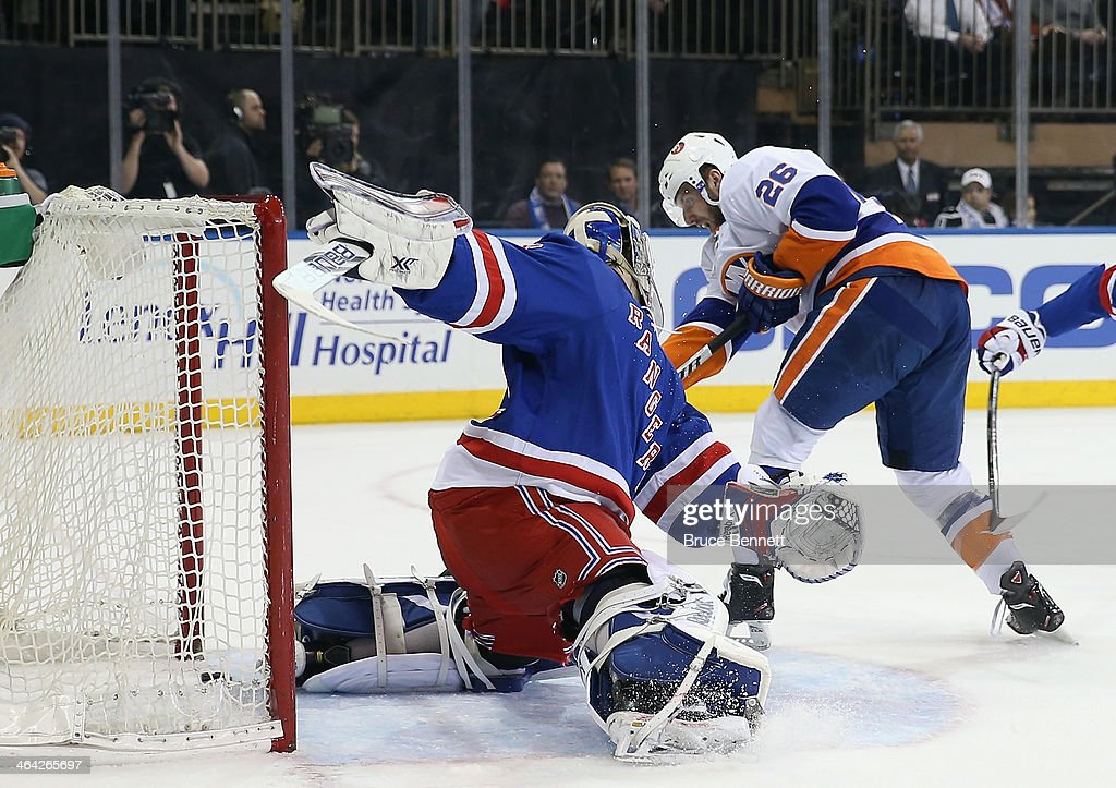 <a gi-track='captionPersonalityLinkClicked' href=/galleries/search?phrase=Thomas+Vanek&family=editorial&specificpeople=570606 ng-click='$event.stopPropagation()'>Thomas Vanek</a> #26 of the New York Islanders scores the game winning powerplay goal at 15:22 of the third period against <a gi-track='captionPersonalityLinkClicked' href=/galleries/search?phrase=Cam+Talbot&family=editorial&specificpeople=7185126 ng-click='$event.stopPropagation()'>Cam Talbot</a> #33 of the New York Rangers at Madison Square Garden on January 21, 2014 in New York City. The Islanders defeated the Rangers 5-3.