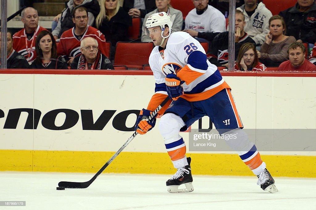 Thomas Vanek #26 of the New York Islanders skates with the puck against the Carolina Hurricanes at PNC Arena on November 7, 2013 in Raleigh, North Carolina.
