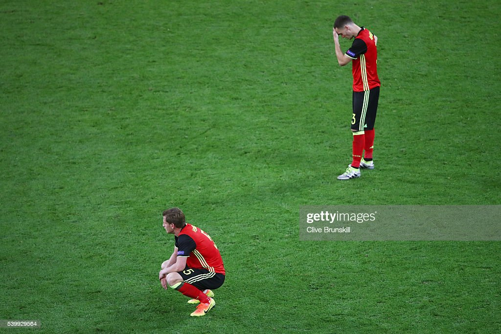 Thomas Vermaelen and Jan Vertonghen of Belgium show their dejection after Italy's second goal during the UEFA EURO 2016 Group E match between Belgium...