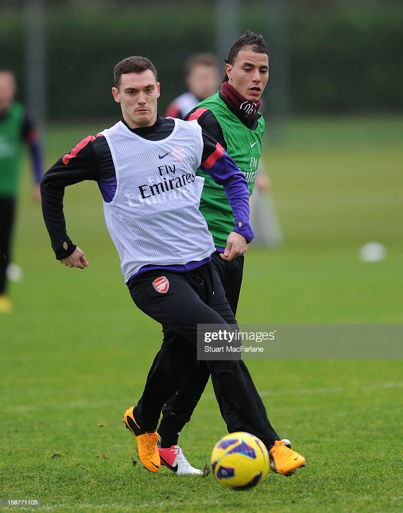<a gi-track='captionPersonalityLinkClicked' href=/galleries/search?phrase=Thomas+Vermaelen&family=editorial&specificpeople=1360240 ng-click='$event.stopPropagation()'>Thomas Vermaelen</a> and <a gi-track='captionPersonalityLinkClicked' href=/galleries/search?phrase=Marouane+Chamakh&family=editorial&specificpeople=727555 ng-click='$event.stopPropagation()'>Marouane Chamakh</a> of Arsenal during a training session at London Colney on December 28, 2012 in St Albans, England.