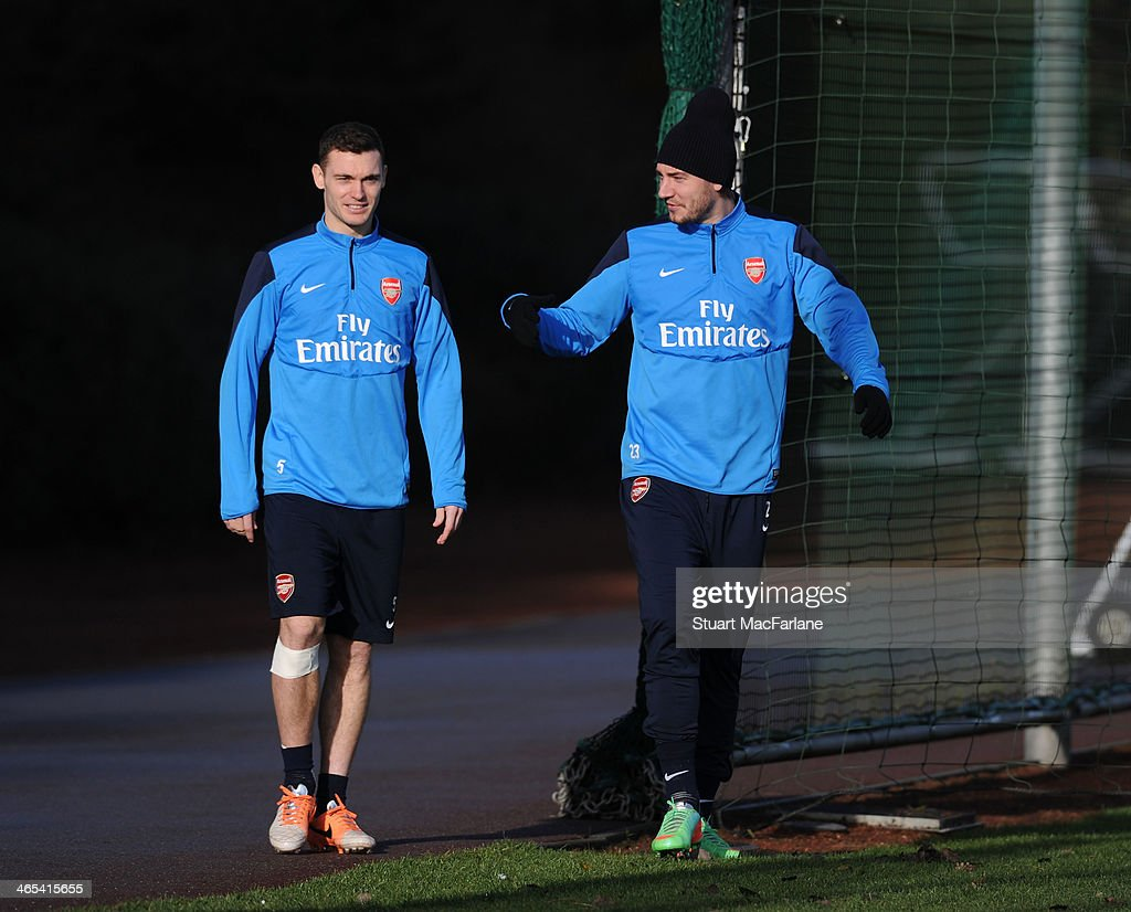 Thomas Vermaelen and Nicklas Bendtner of Arsenal before a training session at London Colney on January 27, 2014 in St Albans, England.