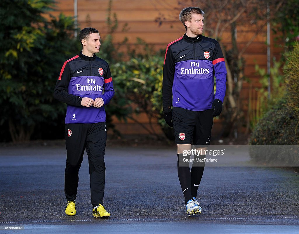 Thomas Vermaelen and Per Mertesacker of Arsenal before a training session at London Colney on December 07, 2012 in St Albans, England.