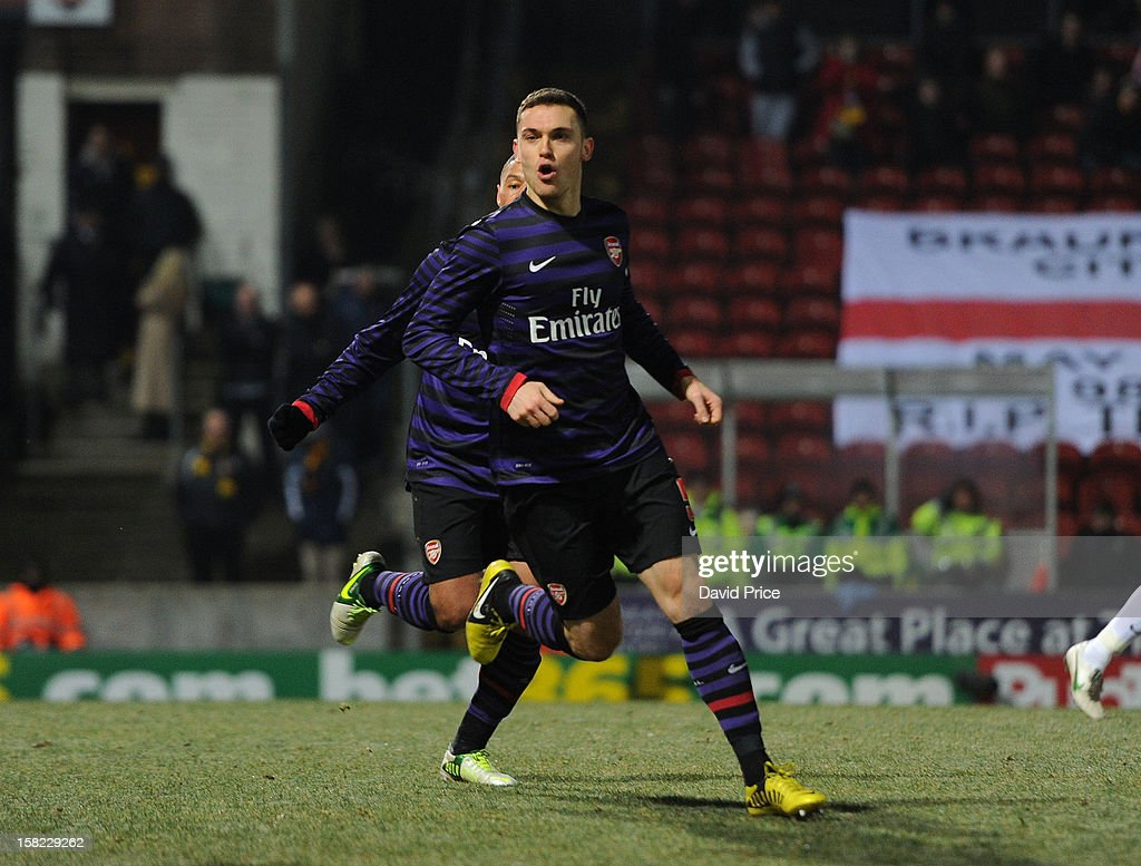 Thomas Vermaelen celebrates scoring Arsenal's goal during the Capital One Cup match between Arsenal and Bradford City at Coral Windows Stadium, Valley Parade on December 11, 2012 in Bradford, England.