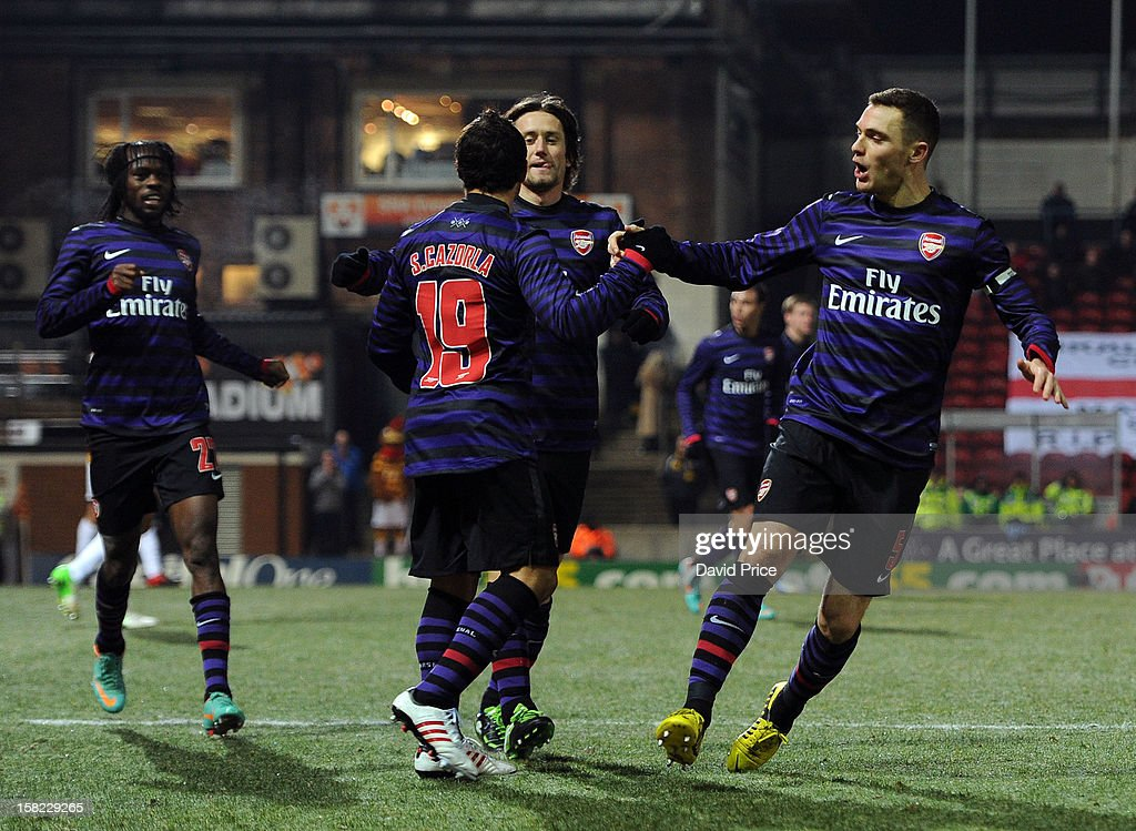 Thomas Vermaelen celebrates scoring Arsenal's goal with Santi Cazorla and Tomas Rosicky during the Capital One Cup match between Arsenal and Bradford City at Coral Windows Stadium, Valley Parade on December 11, 2012 in Bradford, England.
