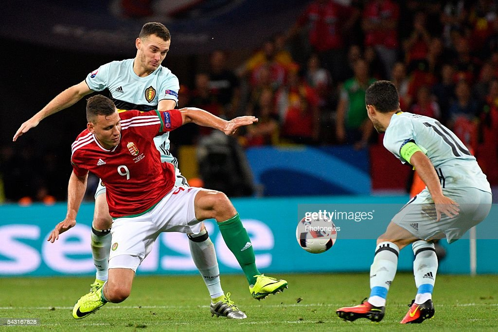 Thomas Vermaelen defender of Belgium battles for the ball with Ádam Szalai forward of Hungary during the UEFA EURO 2016 Round of 16 match between Hungary and Belgium at the Stadium Toulouse on June 26, 2016 in Toulouse, France ,