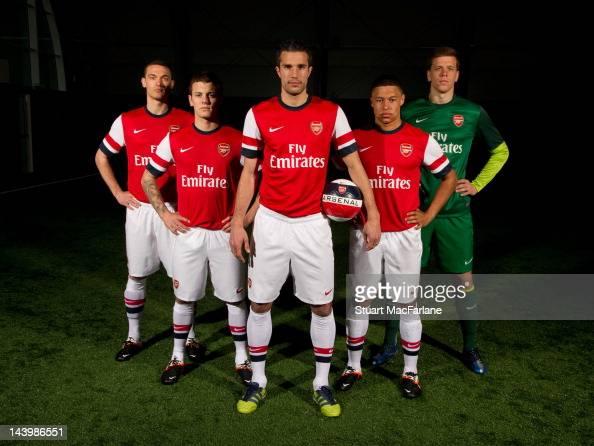 Thomas Vermaelen Jack Wilshere Robin van Persie Alex OxladeChamberlain and Wojciech Szczesny pose during a photoshoot for the new Arsenal home kit...