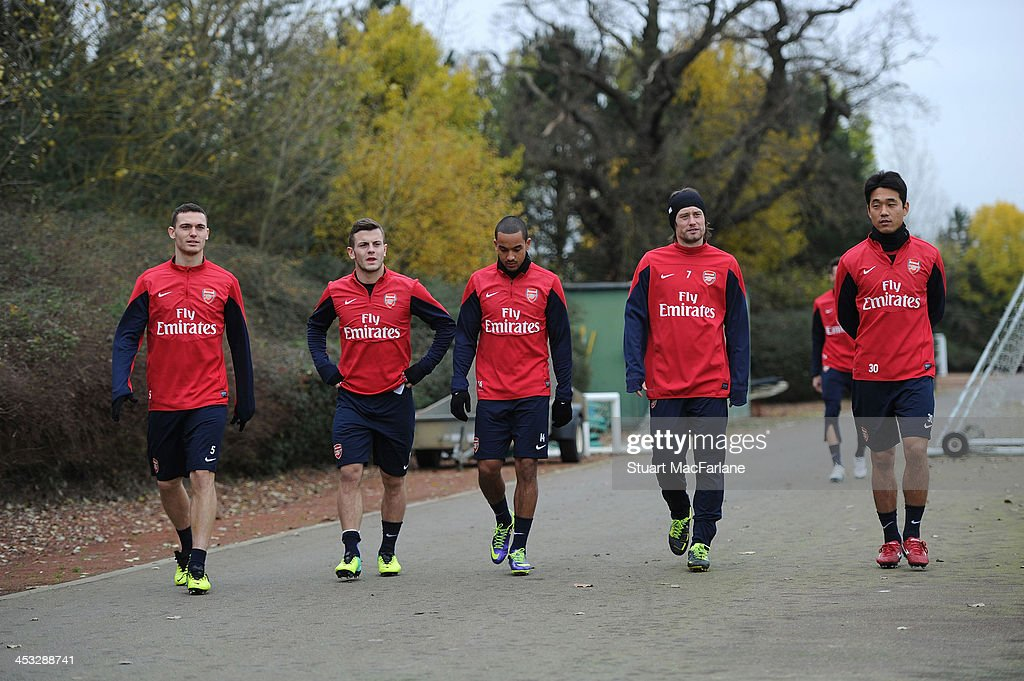 Thomas Vermaelen, Jack Wilshere, Theo Walcott, Tomas Rosicky and Ju-Young Park of Arsenal arrive for a training session at London Colney on December 3, 2013 in St Albans, England.