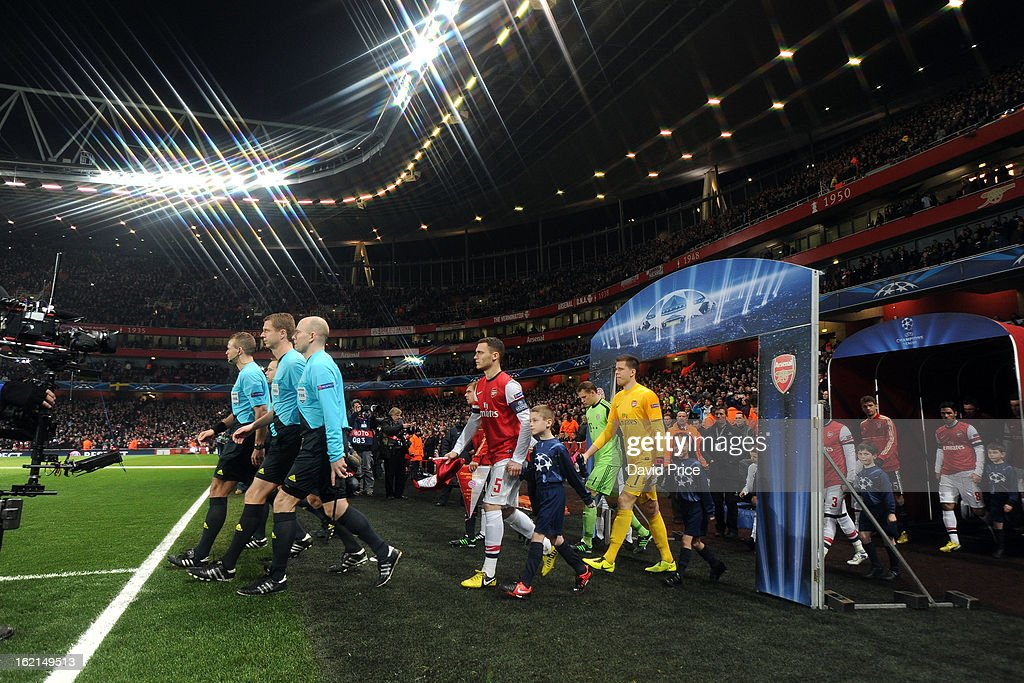 Thomas Vermaelen leads out the Arsenal players before the UEFA Champions League Round of 16 first leg match between Arsenal FC and Bayern Muenchen at Emirates Stadium on February 19, 2013 in London, England.
