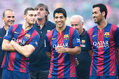 Thomas Vermaelen Luis Suarez and Sergio Busquets of FC Barcelona share a joke during the official presentation of the FC Barcelona prior to the Joan...