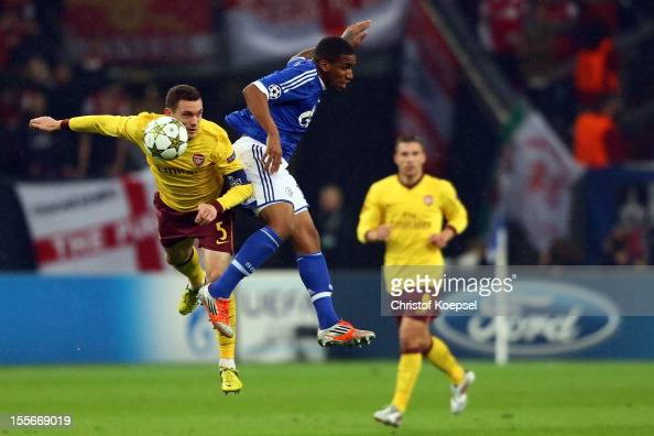 Thomas Vermaelen of Arsenal and Jefferson Farfan of Schalke go up for a header during the UEFA Champions League group B match between FC Schalke 04...