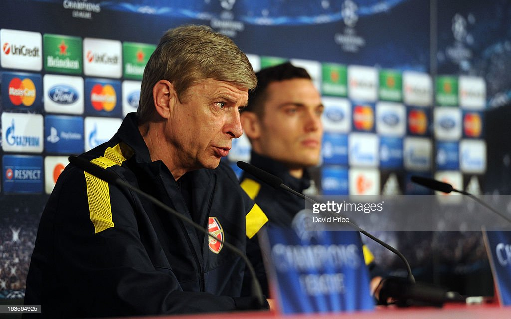 Thomas Vermaelen (R) of Arsenal and their manager <a gi-track='captionPersonalityLinkClicked' href=/galleries/search?phrase=Arsene+Wenger&family=editorial&specificpeople=171184 ng-click='$event.stopPropagation()'>Arsene Wenger</a> during a Press Conference ahead of their UEFA Champions League Round of 16 match against Bayern Munich at Allianz Arena on March 12, 2013 in Munich, Germany.