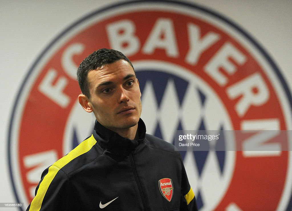 Thomas Vermaelen (R) of Arsenal and their manager Arsene Wenger during a Press Conference ahead of their UEFA Champions League Round of 16 match against Bayern Munich at Allianz Arena on March 12, 2013 in Munich, Germany.