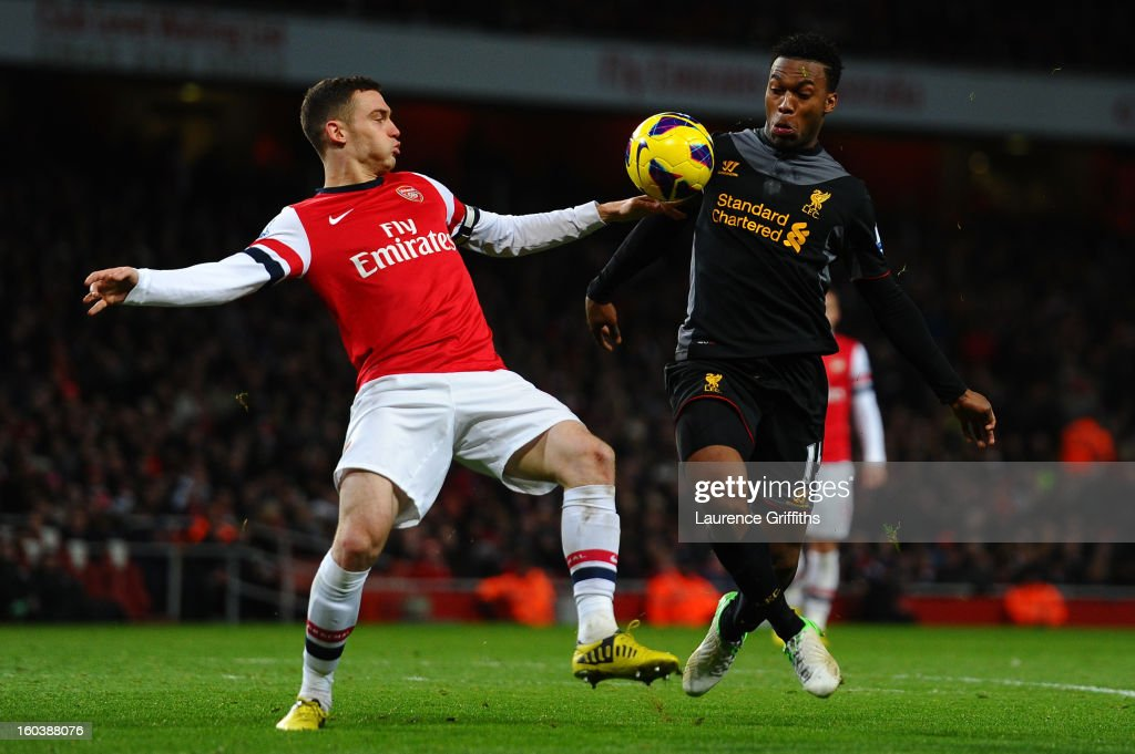 Thomas Vermaelen of Arsenal appears to handle the ball in the area as he competes for the ball with Daniel Sturridge of Liverpool during the Barclays Premier League match between Arsenal and Liverpool at Emirates Stadium on January 30, 2013 in London, England.
