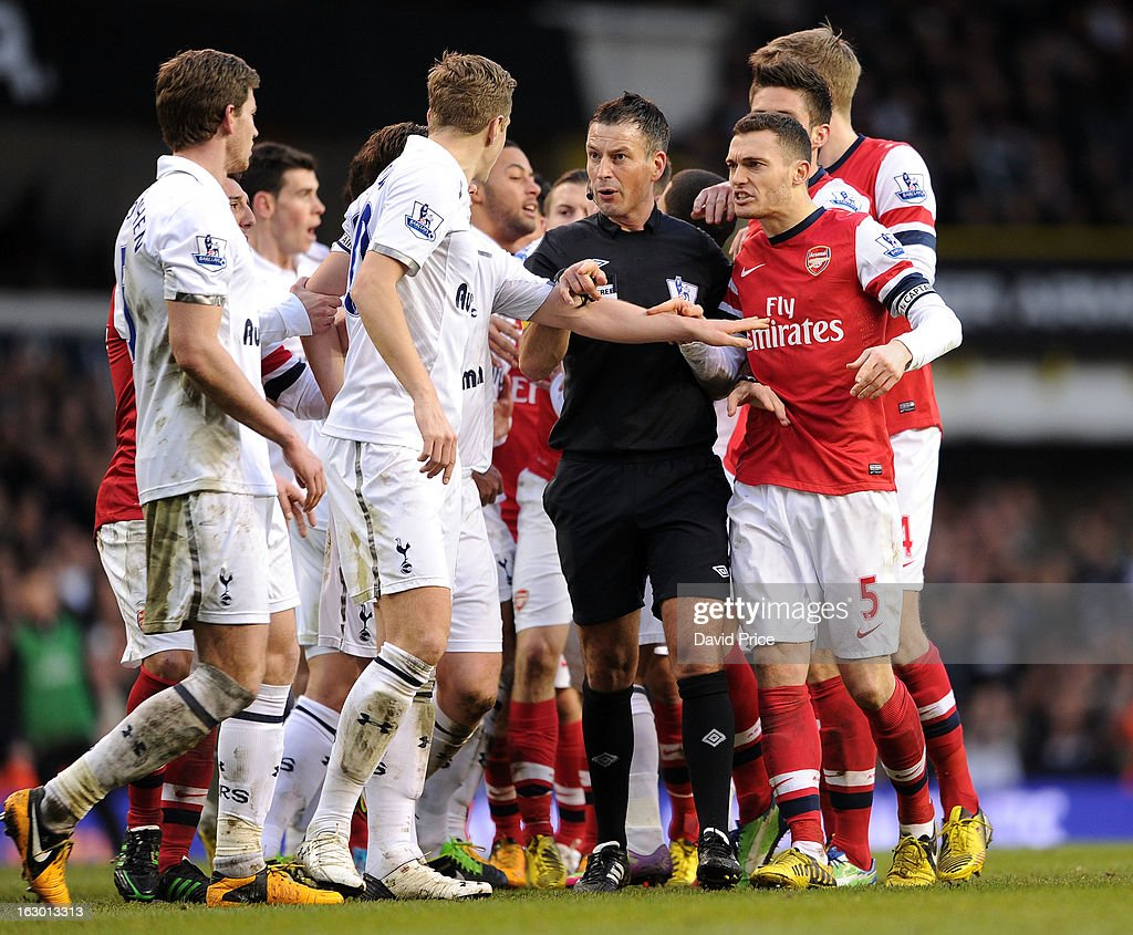 Thomas Vermaelen of Arsenal argues with Michael Dawson of Tottenham as Referee Mark Clattenburg trys to keep controls of the match during the Barclays Premier League match between Tottenham Hotspur and Arsenal at White Hart Lane on March 01, 2013 in London, England.