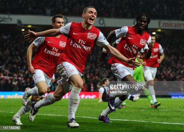 Thomas Vermaelen of Arsenal celebrates scoring their second goal during the Barclays Premier League match between Arsenal and Newcastle United at...