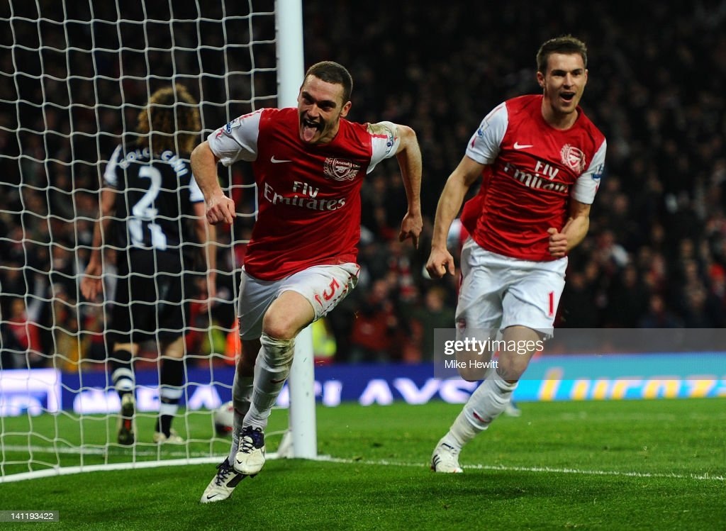<a gi-track='captionPersonalityLinkClicked' href=/galleries/search?phrase=Thomas+Vermaelen&family=editorial&specificpeople=1360240 ng-click='$event.stopPropagation()'>Thomas Vermaelen</a> of Arsenal celebrates scoring their second goal during the Barclays Premier League match between Arsenal and Newcastle United at Emirates Stadium on March 12, 2012 in London, England.