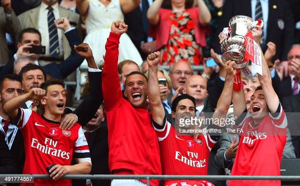 Thomas Vermaelen of Arsenal celebrates with his teammates as he lifts the FA Cup after the FA Cup with Budweiser Final match between Arsenal and Hull...
