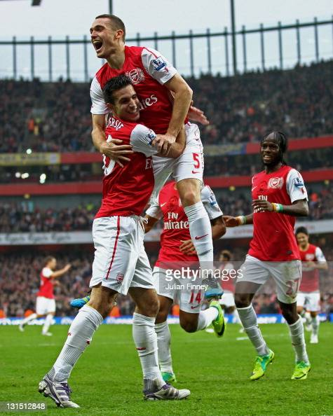 Thomas Vermaelen of Arsenal celebrates with teammate Robin van Persie after scoring his team's second goal during the Barclays Premier League match...