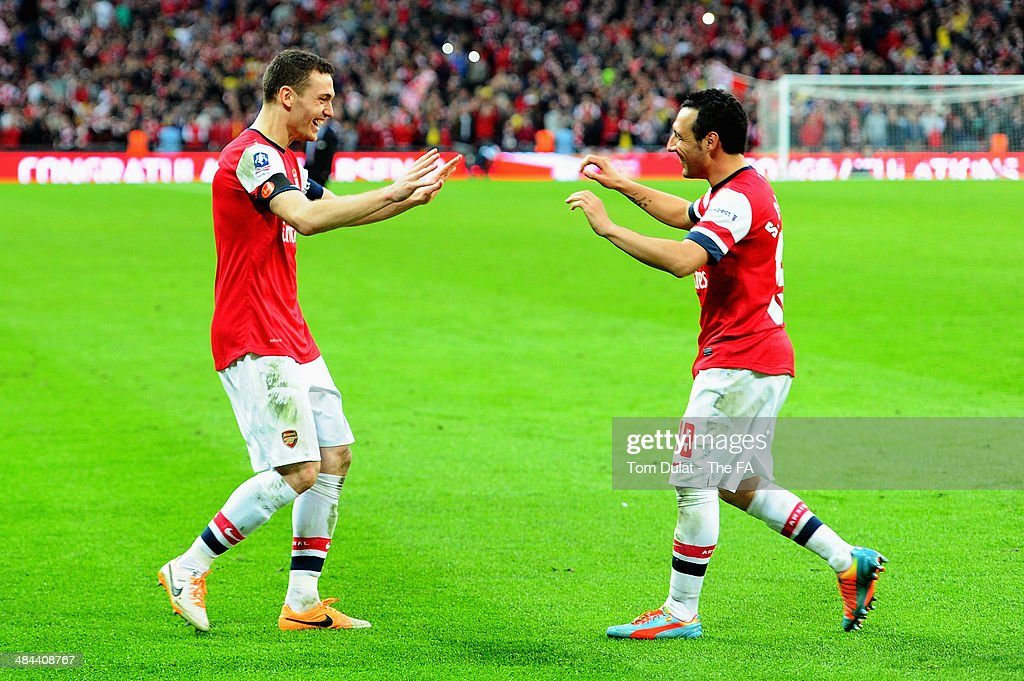 Thomas Vermaelen of Arsenal celebrates with teammate Santi Cazorla of Arsenal during the FA Cup SemiFinal match between Wigan Athletic and Arsenal at...
