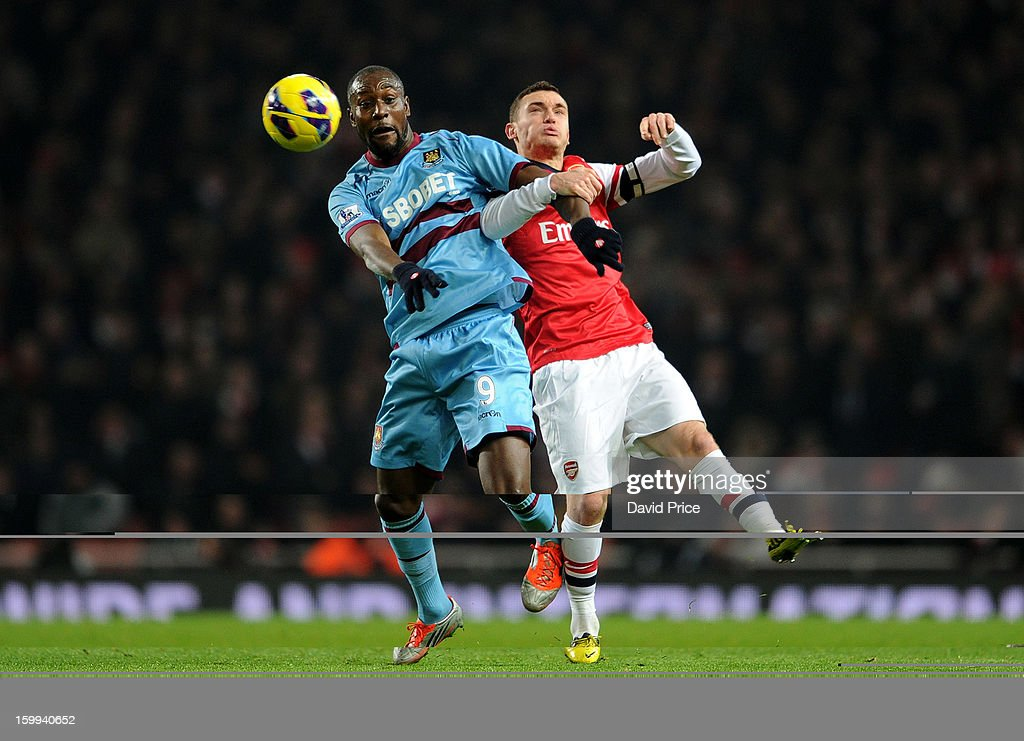 Thomas Vermaelen of Arsenal challenges Carlton Cole of West Ham during the Barclays Premier League match between Arsenal and West Ham United at Emirates Stadium on January 23, 2013 in London, England.