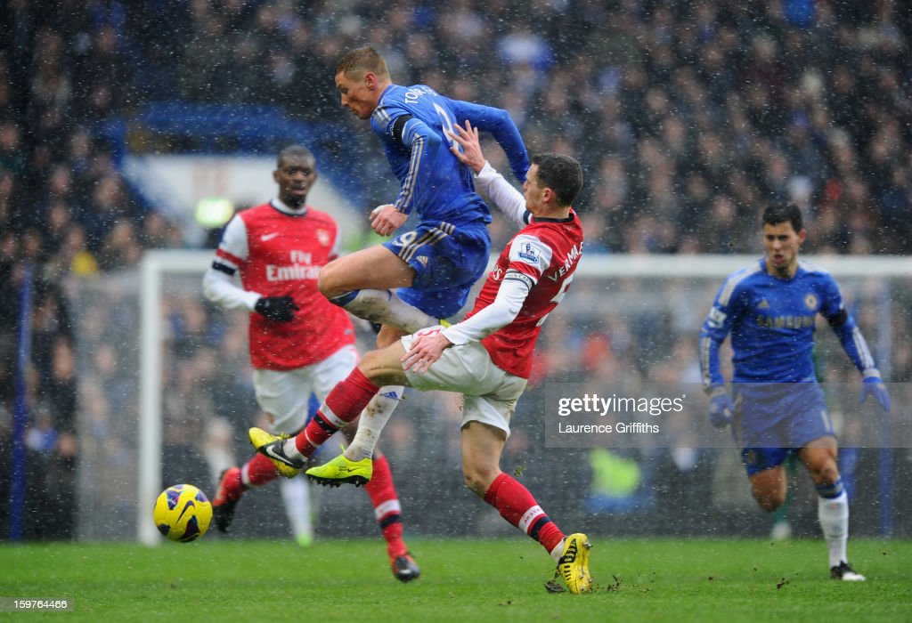 Thomas Vermaelen of Arsenal challenges Fernando Torres of Chelsea during the Barclays Premier League match between Chelsea and Arsenal at Stamford Bridge on January 20, 2013 in London, England.